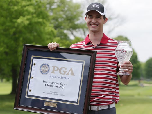 Tuesday May 20th, 2014, Jon Jozefowski, 23, holds his championship plaque, and vase after maintained his lead to win the Indianapolis Open, at Highland Country Club. Jozefowski's win came a month after the passing of his father, John Jozefowski.