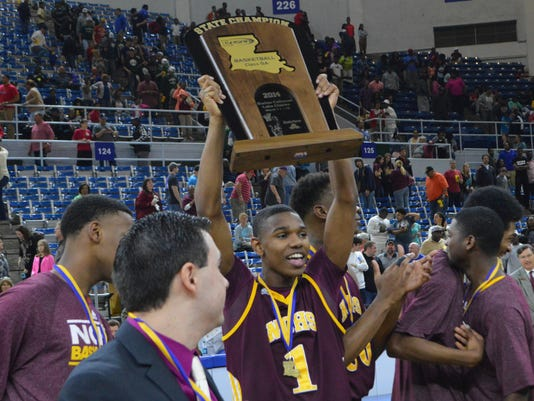 ANI Natchitoches Central vs. Scotlandville Natchitoches Central's Ricky Metoyer (1) holds up the championship trophy after Natchitoches won the Class 5A division of the 2014 Boys' State Basketball Championship Friday, March 15, 2014 in Lake Charles.-Melind