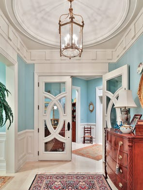 Step inside the foyer, which features a domed ceiling.