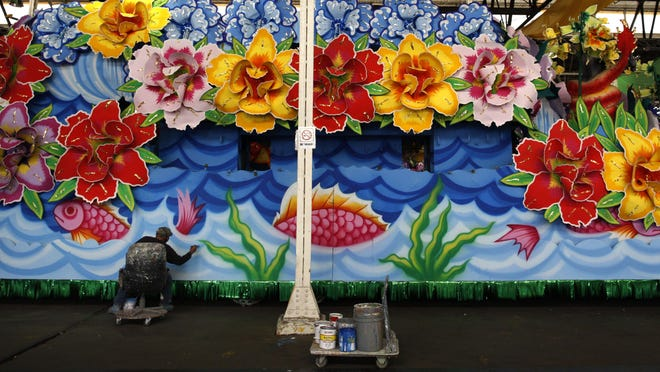 Mardi Gras master float painter Raymond Joseph Bowie Sr. paints a float at Kern Studios in New Orleans. Bowie has been painting Mardi Gras floats for nearly 40 years.