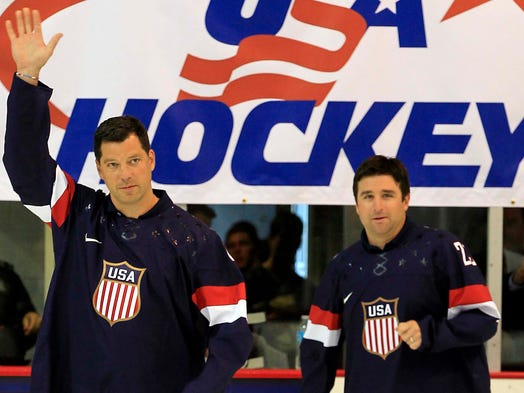 Former Olympians Bill Guerin and Chris Drury were the first to walk onto the ice with the 2014 Team USA jersey.