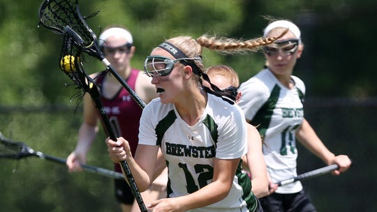 Brewster's Megan Beal (12) drives to the goal against
