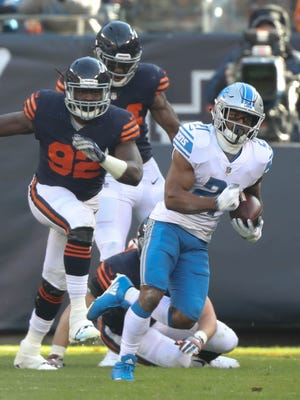 Ameer Abdullah runs by the Chicago Bears' Pernell McPhee in the third quarter of the Detroit Lions' 27-24 win Sunday, Nov. 19, 2017 at Soldier Field in Chicago.