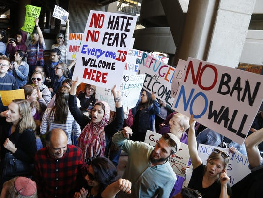 Protesters chant during a rally at Phoenix Sky Harbor