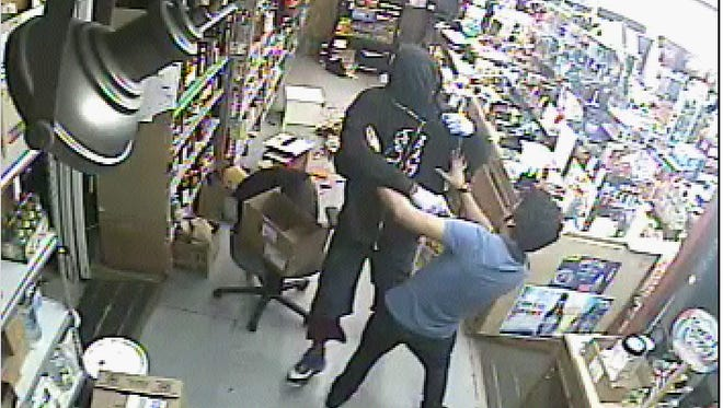 This surveillance footage shows an armed robbery taking place at the Kajeune's Country Corner convenience store on Union Street.