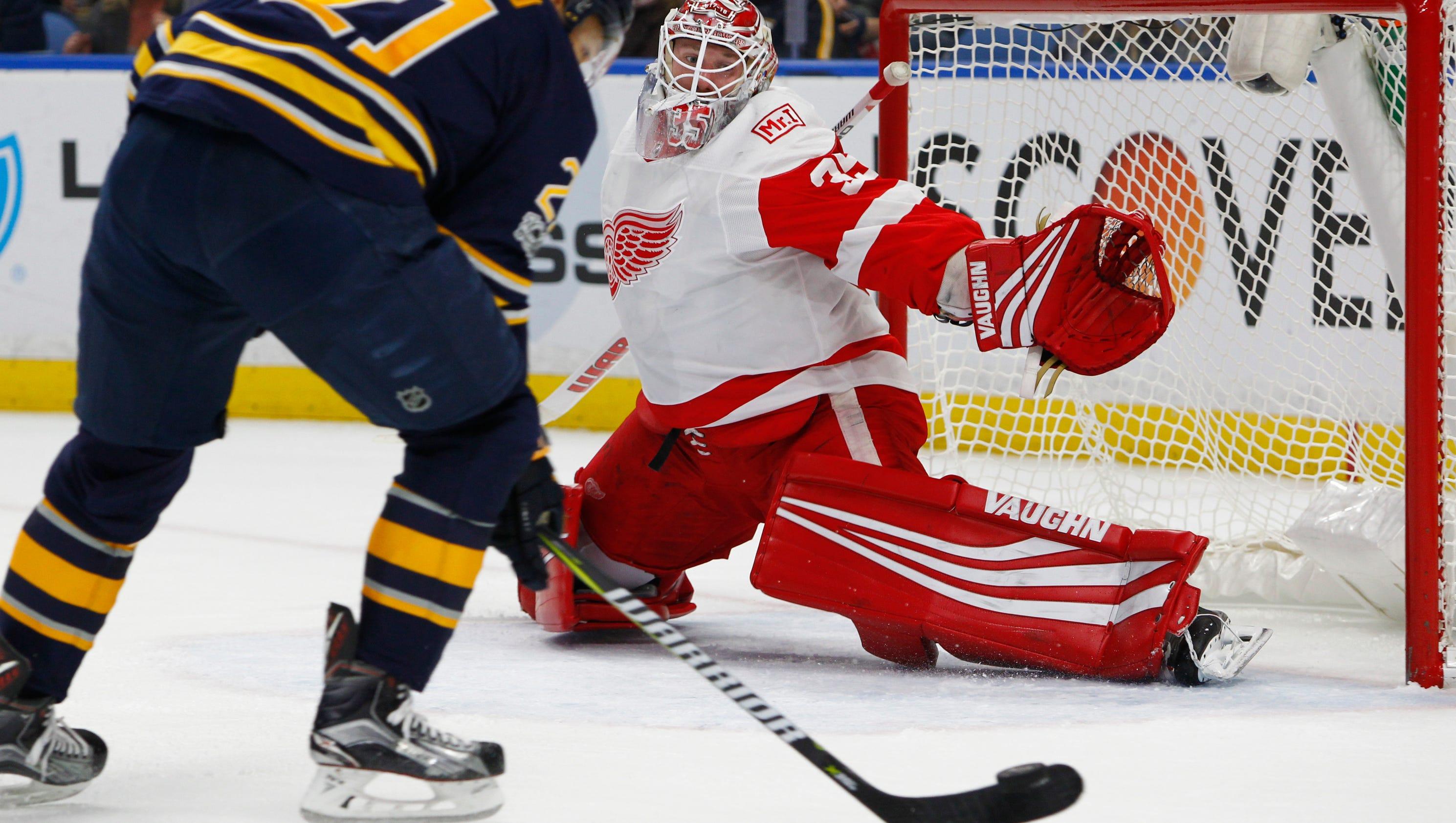 636444783572196852-ap-red-wings-sabres-hockey-n-3-