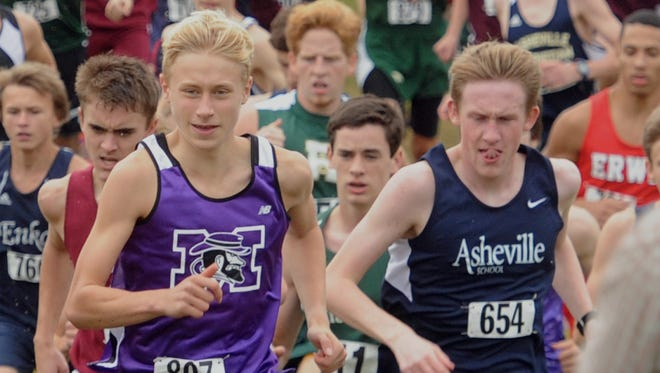 Mitchell senior Zach Boone, left, was the NCHSAA 1-A cross country champion in 2013.