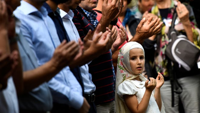 Mourners at a funeral the day after bombings at Ataturk Airport, Istanbul, Turkey on June 29, 2016.