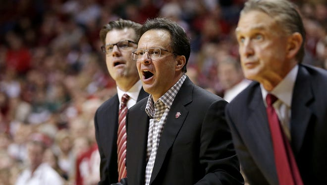 Indiana Hoosiers head coach Tom Crean and other IU coaches look on in shock during the second half of their game on March 7, 2015, afternoon at Assembly Hall in Bloomington, when the Michigan State Spartans defeated the Hoosiers, 74-72.