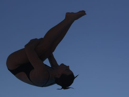 Chiles' Rainey Vause dives during Wednesday's Region