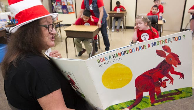 Donna Djerf, a family liason with Lee County Schools, reads to a class at the Buckingham Exceptional Student Center on Wednesday.
