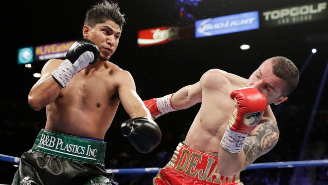 Pacifica High graduate Mikey Garcia, left, connects with a left to the face of Dejan Zlaticanin during their fight on Jan. 28 in Las Vegas. The unbeaten Garcia is open to a fight with Vasyl Lomachenko.