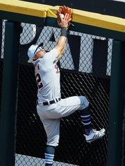 Tigers center fielder Leonys Martin makes a catch at