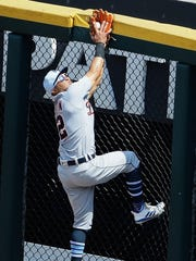 Tigers center fielder Leonys Martin makes a catch at