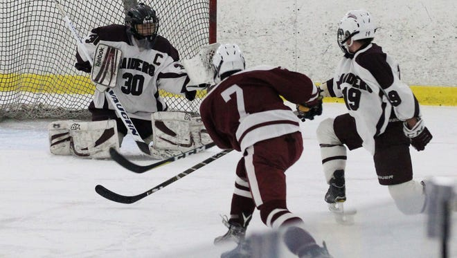 Fordham Prep's Colin Rueda shoots on Scarsdale goalie Sam Seltzer during their game at the Ice Hutch Dec. 8, 2017. Fordham Prep won 4-3.
