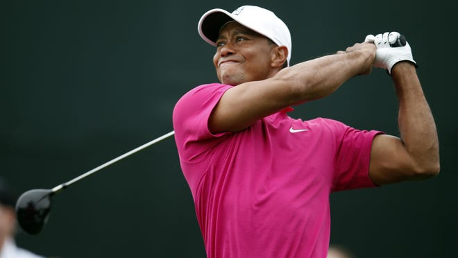 """Rick Scuteri/AP fileAfter two trips to Augusta National this week, Tiger Woods announced his return to competition on his website Friday. FILE - In this Jan. 29, 2015, file photo, Tiger Woods tees off on the 17th hole during the first round of the Phoenix Open golf tournament in Scottsdale, Ariz. Tiger Woods has made up his mind _ he will play the Masters. After two trips to Augusta National this week, Woods announced his return to competition on his website Friday, April 3, 2015. He wrote: """"I'm playing the Masters. It's obviously very important to me, and I want to be there.""""(AP Photo/Rick Scuteri, File)"""