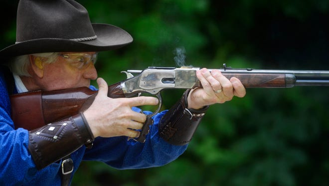 Bill Jensen, who goes by Wild Bill Diamond, shoots an 1890's era rifle. Cowboys shoot four different guns and move from place to place as they work through each scenario, often in under 30 seconds.