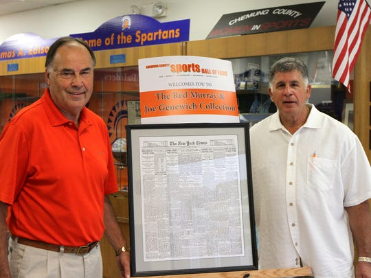 Chemung County Sports Hall of Fame President Marty Chalk, left, with Bill Morrell, who helped provide memorabilia for the display at the Chemung County Sports Hall of Fame at the Arnot Mall.