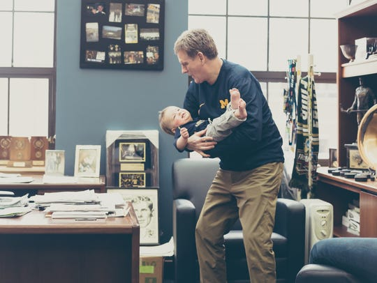 Michigan hockey coach Mel Pearson plays with his grandson,