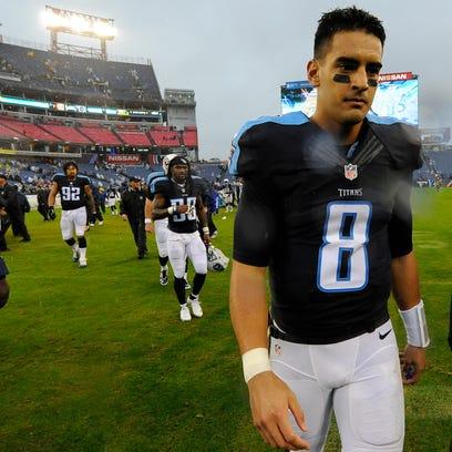 Titans quarterback Marcus Mariota (8) looks dejected