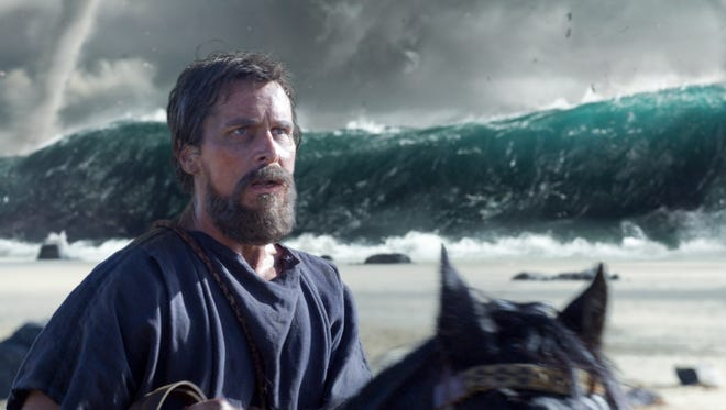 Moses (Christian Bale) leads his followers through a tsunami in 'Exodus: Gods and Kings.'