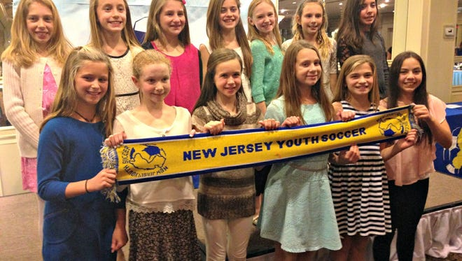 The U11 Middletown Sonic Dynamite Red celebrated their Fall NCS State Cup championship victory with nearly 500 attendees at NJ Youth Soccer's 27th annual awards dinner held in Edison.