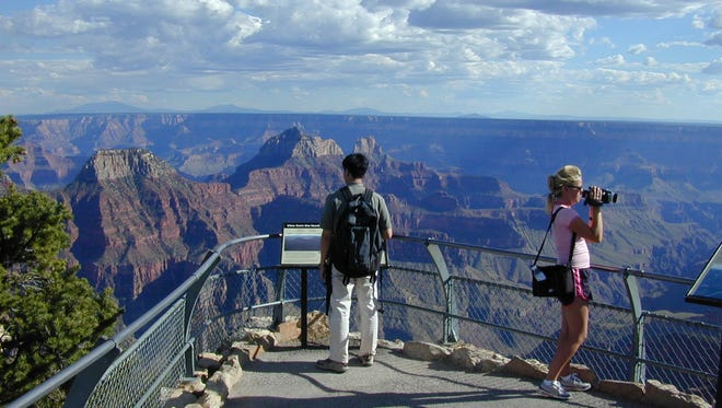 Visitors take in the view from the Bright Angel Overlook on the North Rim of the Grand Canyon.