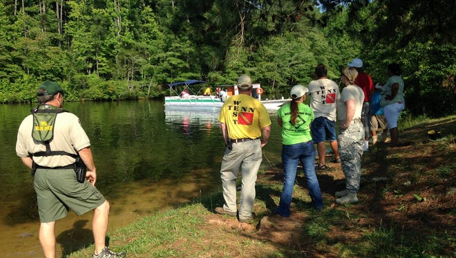 Dive teams are searching Pine Lake in response to a possible drowning.