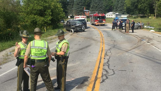 Vermont State Police troopers investigate a crash along U.S. 7 in Swanton Thursday afternoon.