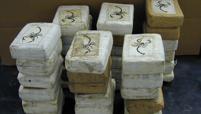 In this file photo, packages of cocaine display the scorpion logo, which has been connected to the Sinaloa Cartel. Four Coachella men have been charged with helping the cartel launder money and smuggle drugs such as cocaine and methamphetamine.