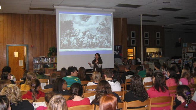 English teacher Kate Baker lectures ninth grade students at Southern Regional High School about the Trojan War in this 2009 file photo.