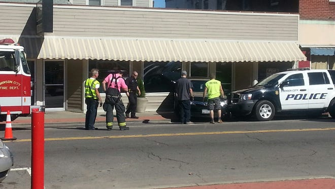 A driver backed into a Johnson City police vehicle outside the Reveille Restaurant on Main Street Monday afternoon. No one was injured.