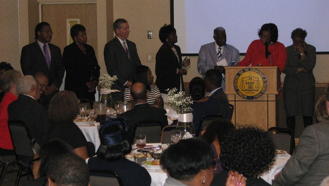 From the left, Joe Shakeenab, City Councilwoman Wanda Smith, state Rep. Joe Pitts,  Mary McIntosh, Pastor Jerry Jerkins, JoAnn Garland and Lettie Kendall prepare to honor Jimmie Garland with the Jerry G. Jerkins Community Service award at the NAACP Freedom Fund Banquet Friday night.