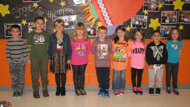 First-grade Students of the Month for October at Mary F. Janvier School are: (from left) Robert Felmey, Gavin Mayo, Carly String, Ava Gaglianone, Matthew DeCesari, Hailey Montes, Angelina Caltabiano, O'Thanel Martinez and Sophia Cartwright.