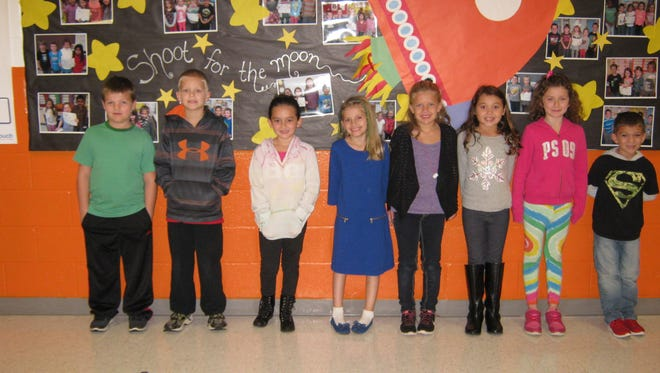 Second-grade Students of the Month for October at Mary F. Janvier School are: (from left) Nathan Whittle, Connor Harrison, Elena Cordova, Evangeline Frank, Rylie Morgan, Nadia Schwester, McKenzy Schneider and Jonathan Pierce.
