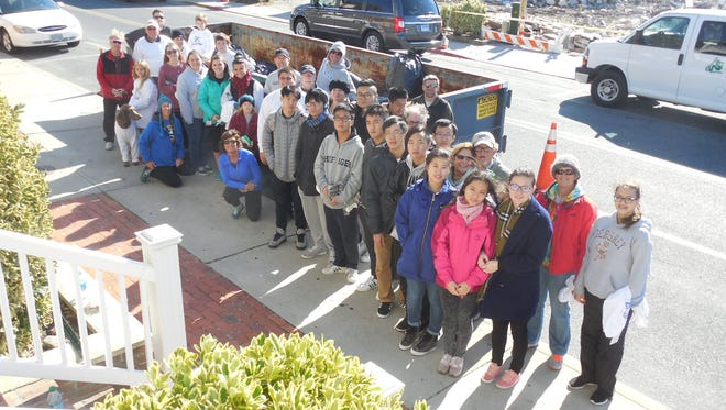 Members of OCDC, its committee and other volunteers took to the streets this past weekend, Nov. 14. to clean up downtown Ocean City.