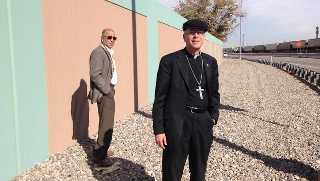 Bishop Mark J. Seitz recently scoped sites along the Border Freeway with Jorge Vergen of the diocese's Catholic Properties.