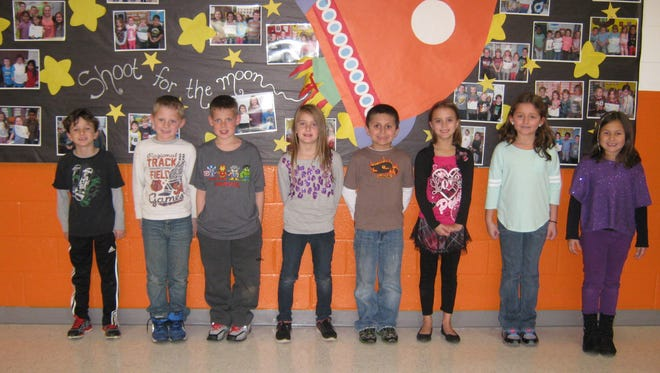 Second graders named Students of the Month for November at Janvier School in Franklin are (from left) Elijah Croce, Ethan Bird, Daniel Bird, Tori Jester, Robert Crane, Peyton Pratt, Hailie Bellone and Emma Natalie.
