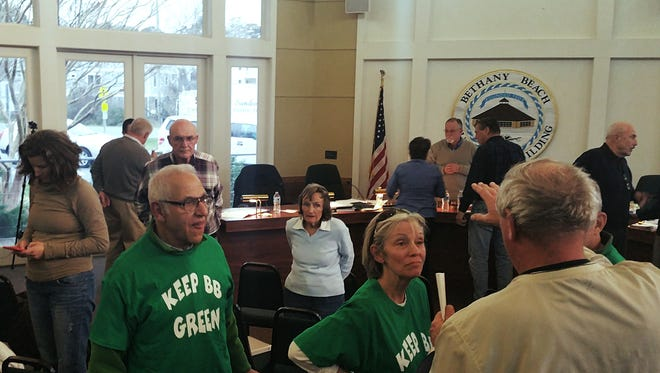 Members of the public discuss Bethany Beach's vote to move an historic cottage to an area on Maryland Avenue at a Jan. 15 council meeting.
