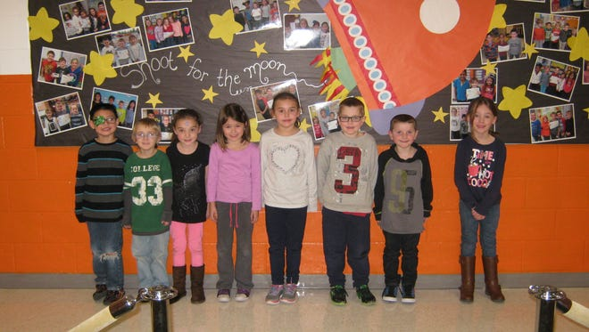 Kindergartners named Students of the Month for December at Janvier School in Franklin are: (from left) Mark Hutton, Caleb Kuhnel, Olivia Guzman, Raeghan Carr, Isabella Pagliarini, Jason Kirkpatrick, Brady Malloy and Riley Cundey.