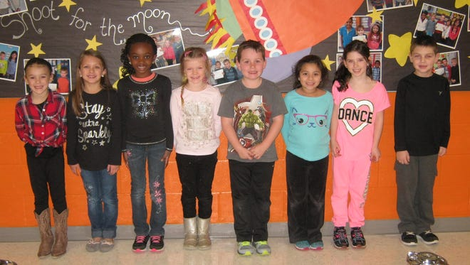 First-graders named Students of the Month for December at Janvier School in Franklin are: (from left) Jocelyn Doyle, Kassidy Porter, Tatiyana Matthews, Summer Sougstad, Sean McGuckin, Kaylee Chamberlin, Madelyn Putz and Michael Marsh.