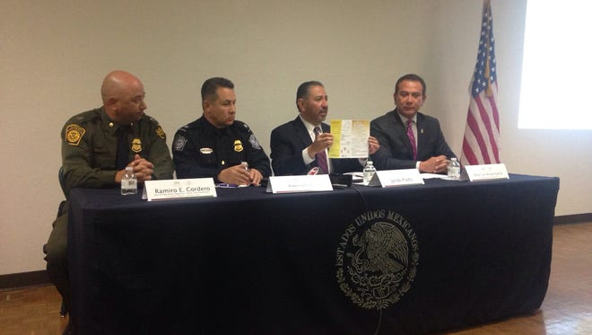 Border Patrol spokesman Ramiro Cordero, from left; Ruben Jauregui, spokesman for U.S. Customs and Border Protection; Jacob Prado, the consul general of Mexico in El Paso; and Oscar Luis Acosta García, Juárez traffic director, speak Friday at a news conference.