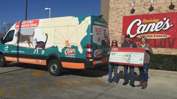 Raising Cane's recently donated money to two area animal rescue organizations.