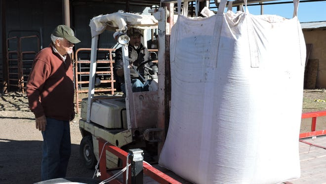 Peter Edmunds of Border partners looked over forklift operator Jorge Lerma as he loads over 2,000 pounds of pinto beans for delivery to Palomas, Chih. Mexico.