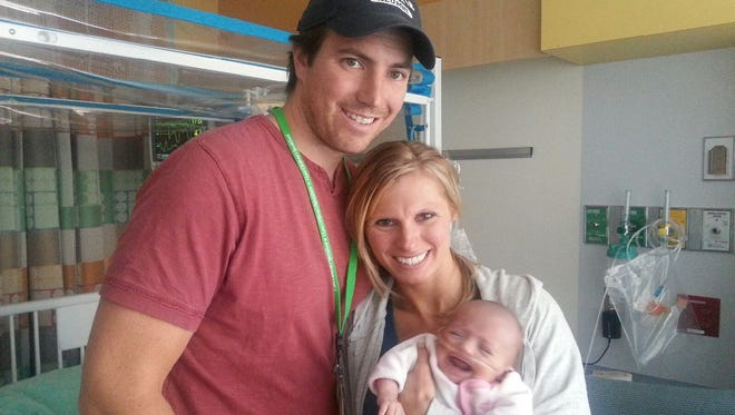 Kim and Fred with their baby girl, Hayden Grace.