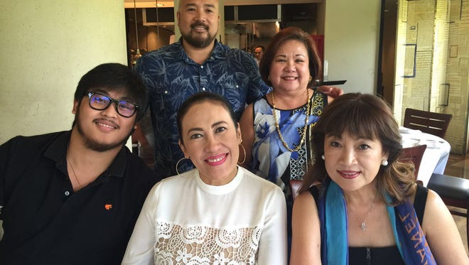 """Filipino Community of Guam officers pose with the """"Philippine Queen of Comedy,"""" Ai-Ai delas Alas, on Friday April 8. Delas Alas will perform with other Filipino and local talent at FCG's Pagkakaisa benefit concert at 5 p.m. April 9 at the University of Guam Calvo Field House. Front row, from left, are: Gerald Sibayan; Ai-Ai delas Alas, the """"Philippine Queen of Comedy""""; and Nita Baldovino, Filipino Community of Guam president. Back row, from left, are: Norman Analista, Filipino Community of Guam first vice president, and Edna Rebanal, Filipino Community of Guam secretary."""