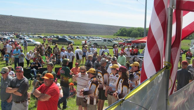 Some of the more than 2,000 persons at the weigh-in f the Stockton Lake Tournament with the Stockton lake Dam in the background.