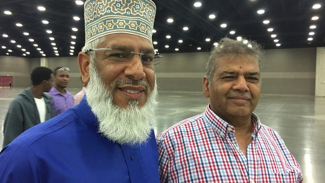 Friends Sohail Kaushal, left,  and Muhammad Khalil traveled from Manchester, England for Thursday's Muslim prayer service for Muhammad Ali.