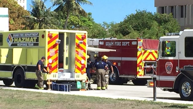 A Guam Fire Department Hazmat team, along with other local and federal authorities, respond to a suspicious package in Hagåtña.