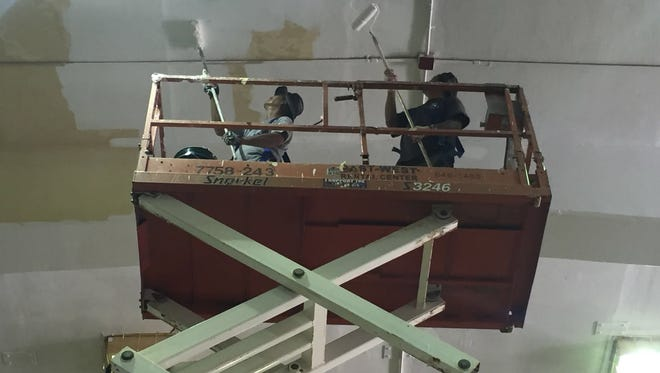 In this file photo, Guam Department of Education maintenance personnel repaint the ceiling of the Simon Sanchez High School gym.